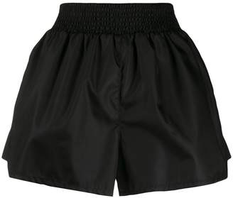 Prada enamel logo patch shorts