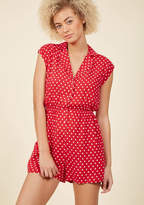 160047e Spend a winning afternoon with a bittersweet love story, hot tea, and the cool comfort of this collared romper. Sporting its vintage-inspired design, red-and-white dotted fabric, smocked waistline, and slit pockets, you know you'll look back fondly on thi