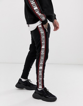 Couture The Club Club taped tracksuit bottoms-Black