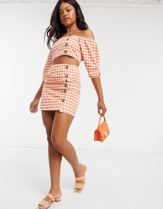 Influence mini skirt with button detail in gingham co-ord