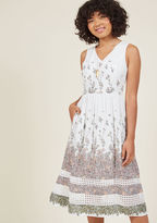 23758D To show your appreciation for such a sunny day, you throw together an outdoor dance party - the perfect occasion in which to debut this white midi dress! As you sashay between guests in the sheer, eyeleted back, matching skirt inserts, and pastel florals