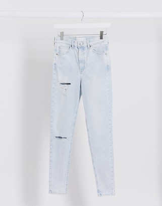 Topshop ripped Jamie jeans in super bleach wash