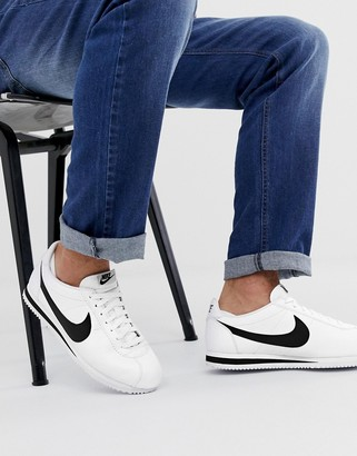 Nike Cortez leather sneakers in white with black swoosh