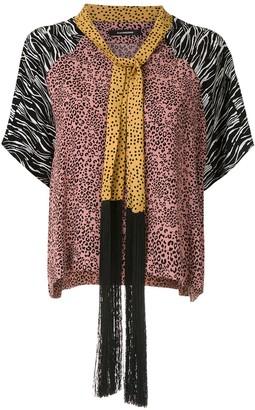 À La Garçonne fringed shawl blouse