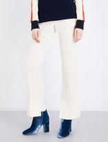 Toga Moire stepped-hem high-rise flared silk-blend trousers