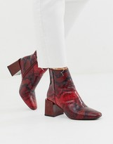 Asos DESIGN Reed heeled ankle boots in red snake