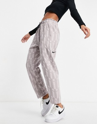 Nike bottoms in light pink with drawstring waist jogger