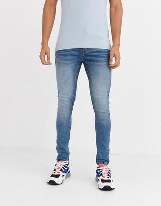 Criminal Damage essential skinny jeans in midblue stone wash