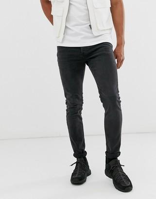 Topman skinny jeans in washed black