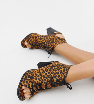Asos DESIGN Wide Fit Truly lace up block heeled sandals in leopard