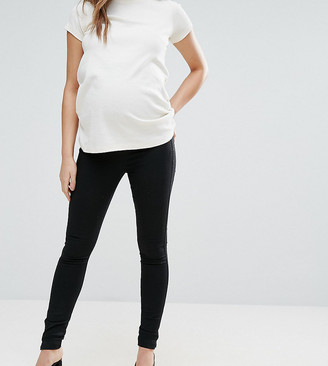 ASOS DESIGN Maternity pull on jeggings in washed black with over the bump waistband