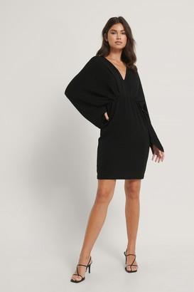 NA-KD Batwing Glitter Mini Dress