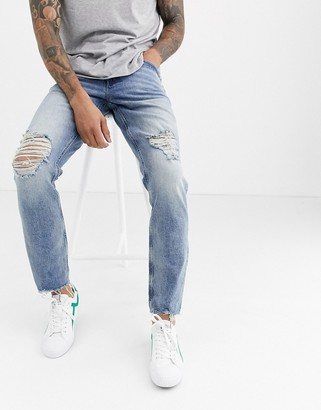 Asos Design DESIGN rigid slim 'american classic' jeans in vintage light wash with rips and raw hem