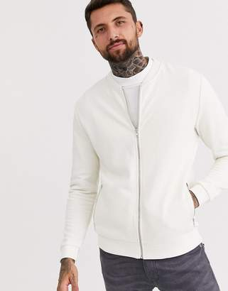 Asos Design DESIGN jersey bomber jacket in off white with silver zip pockets