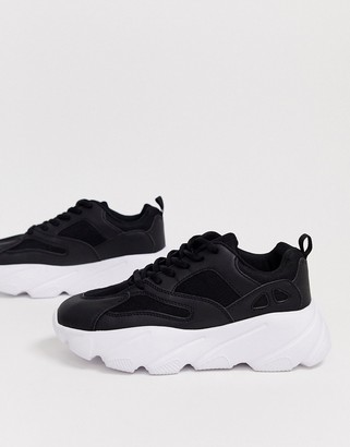 Truffle Collection chunky sneaker in black