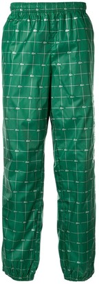 Supreme x Lacoste Reflective Grid track trousers