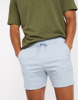 ASOS DESIGN skinny chino shorter shorts with elastic waist in pastel blue