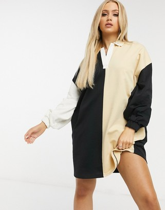 ASOS DESIGN oversized collared mini sweatshirt dress in cream and black half and half colour-block