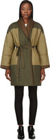 uncategorized  Who made Rihanna green coat, brown print handbag, and tan boots?