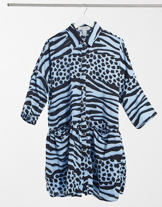 Liquorish mini oversized wrap dress in blue animal print