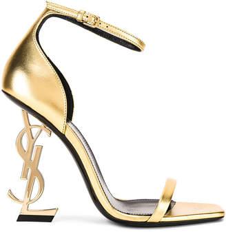 Saint Laurent Logo Ankle Strap Heel in Gold | FWRD