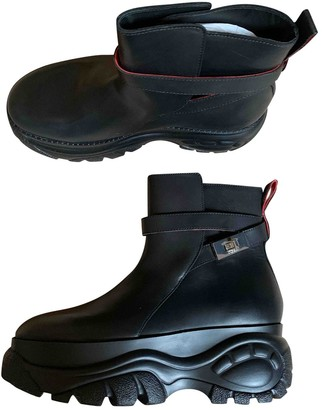 032c Black Leather Trainers