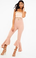PrettyLittleThing Nude Corset Waist Asymmetric Flare Trousers