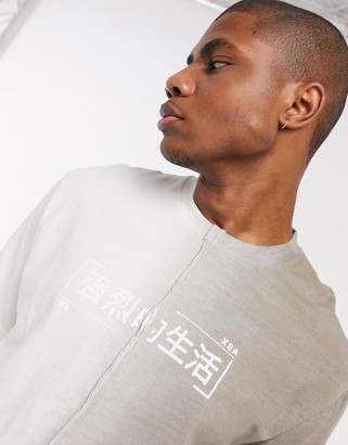 ASOS DESIGN relaxed two tone t-shirt with busted seams and japanese text print