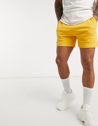 ASOS DESIGN jersey slim shorts in yellow shorter length