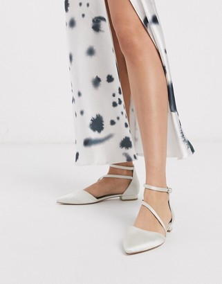 Asos DESIGN Lifetime pointed ballet flats in ivory