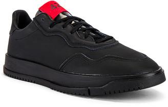 adidas x 424 SC Premier in Black & Black & Scarlet | FWRD