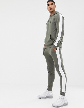 Asos DESIGN tracksuit hoodie/skinny joggers with side stripe in khaki
