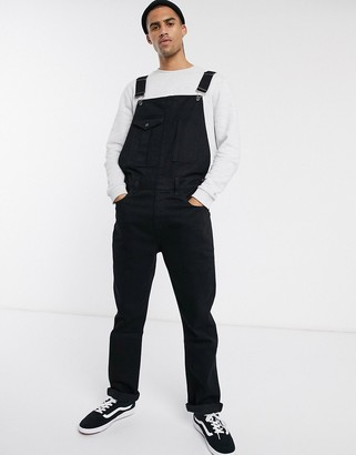 Asos DESIGN denim dungarees with front pocket detail in black