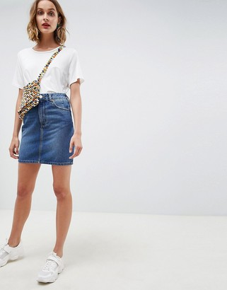 Asos DESIGN denim original high waisted skirt in midwash blue