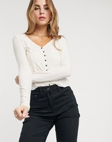 Pieces top with button detail in cream rib