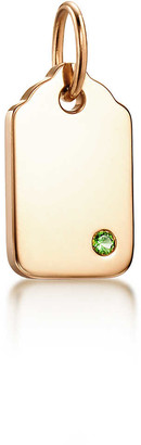 Tiffany & Co. Charms rounded tag in 18k gold with a tsavorite, mini