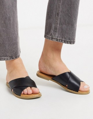 Call it SPRING gracile cross strap flat sandals in black