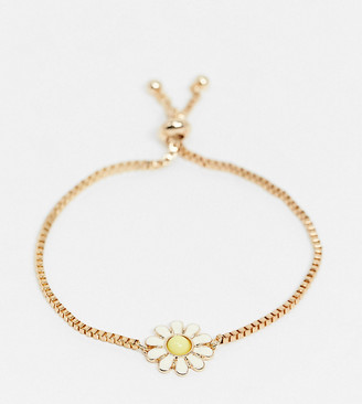 ASOS DESIGN Curve toggle bracelet with daisy charm in gold tone