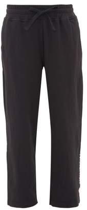 adidas by Stella McCartney Cropped Stepped-hem Jersey Sweatpants - Womens - Black