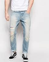 Asos Slim Jeans With Rip And Repair In Bleach Blue