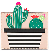 Kate Spade Cactus Card Holder in Beige.