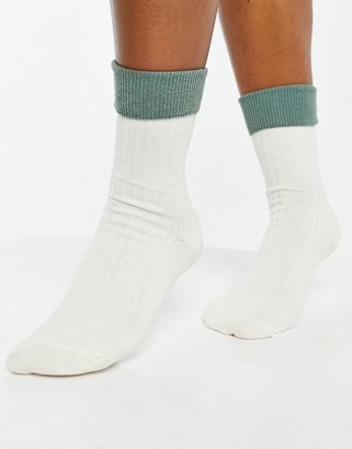 ASOS DESIGN fold top color block socks in cream and sage