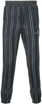 Undercover striped tapered trousers