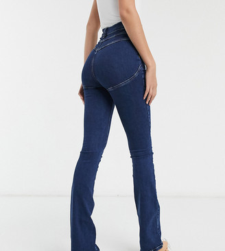 Asos Tall ASOS DESIGN Tall hourglass 'lift and contour' flare jeans in midwash