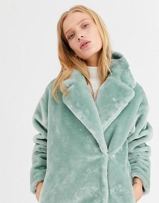Monki short faux fur jacket in sage green