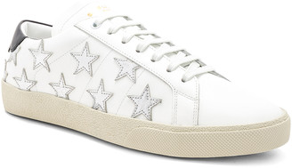 Saint Laurent Star Leather Low Top Sneakers in White & Silver | FWRD