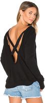 Pam & Gela Open Back Sweatshirt in Black. - size XS (also in )