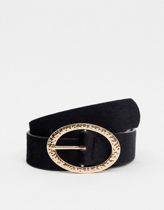 ASOS DESIGN wide belt in black faux pony skin with gold oval buckle