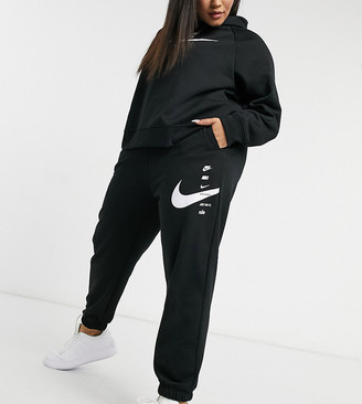 Nike Plus swoosh oversized trackies in black