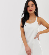 Asos DESIGN Petite denim sundress with tie back in white